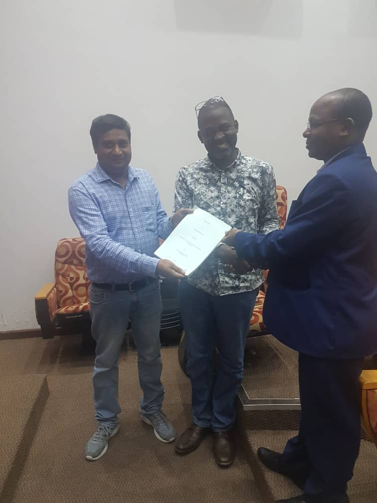 The Government of Tanzania handing over sale contract of raw cashew nuts in Sep 2019